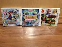 three assorted Nintendo Wii game cases