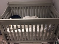 Baby's grey crib and organic mattress