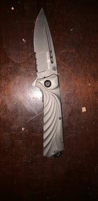 gray and black folding knife Council Bluffs, 51501