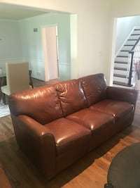 brown leather 3-seat sofa null