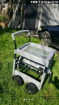 Suncast potting cart with built in hose reel