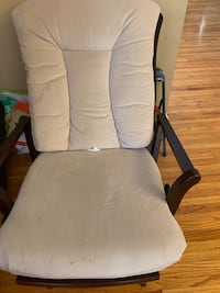 Tan colored glider/rocking chair