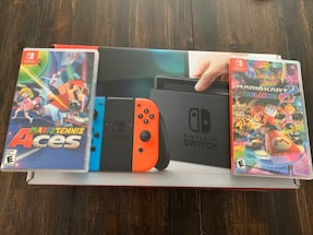 Brand new Nintendo switch with 2 games.
