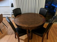 Round wooden dining table with 4 faux leather chairs Vancouver, V5Z 3S6