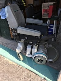 Black, gray, and white motorized wheelchair Valrico, 33594