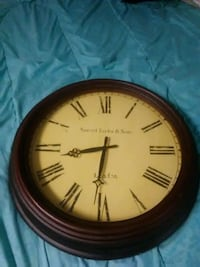 round brown wooden framed analog wall clock 75 km