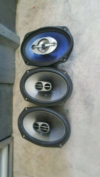 two black-and-blue coaxial speakers