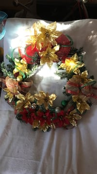 green, red, and gold Christmas wreath
