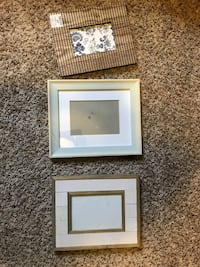 Three rectangular brown and white wooden photo frames