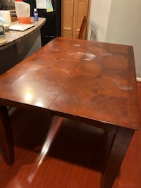 rectangular brown wooden dining table 66 km