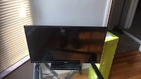black flat screen TV with remote Detroit, 48221