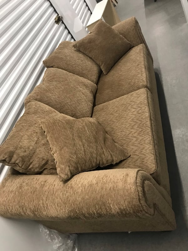 Tan couch with loveseat 37779b3f-1cf2-4179-abcd-fc84ef9f4789