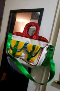 red, green, and yellow leather handbag Toronto, M6M 3A3