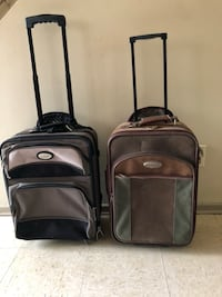 two black leather luggage bags 1958 km