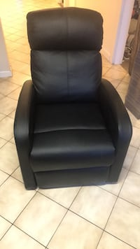 black leather padded rolling armchair, barely used, great condition Toronto, M9L 1B4
