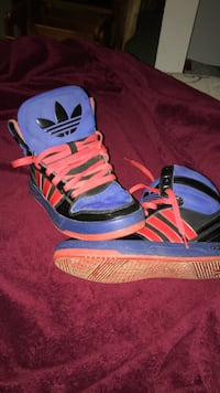 pair of yellow-and-blue Adidas sneakers