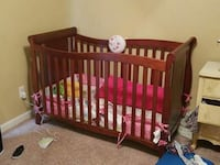 baby's brown wooden crib St. Catharines