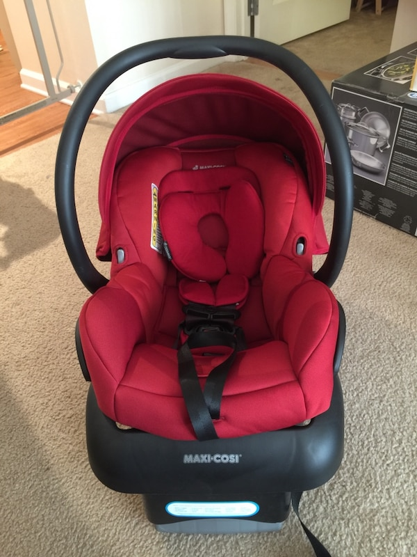 Baby S Red And Black Maxi Cosi Car Seat