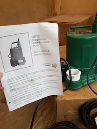 green OSP33 submersible pump with manual