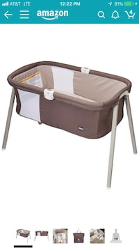 brown and white travel cot Arlington, 22214