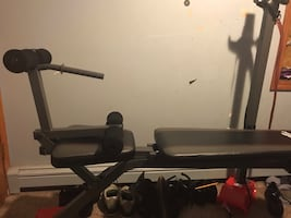 Weight bench with two 25lb weights