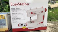 white and red Singer electric sewing machine box Covington, 41015
