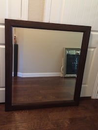 square brown wooden framed mirror