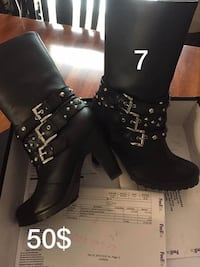 pair of size 7 black leather round-toe chunky-heeled mid-calf boots