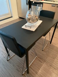 Selling new dining table w/  two chairs.