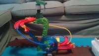 green and multicolored rolling track toy