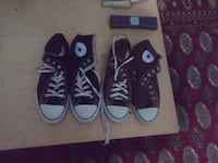 pair of black and brown Converse All Star high top sneakers