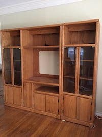 Solid Oak Entertainment Center. Glass doors and top lighting. Message me for the dimensions