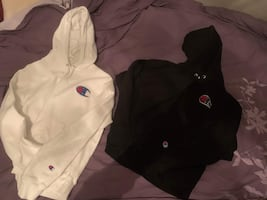 Two women champion hoodies