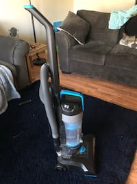 Black and blue upright vacuum cleaner Chantilly, 20151