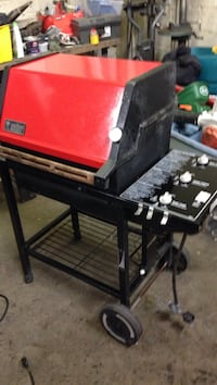 Red and black weber gas grill