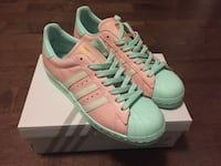 Pair of teal-and-pink Adidas Superstar with box