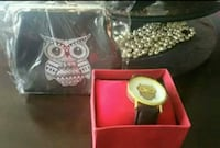 Brand new coin purse with matching Owl watch set. 586 mi