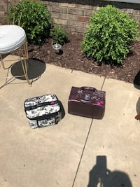 Jewelry/cosmetic cases. Brown one is new. Marysville, 48040