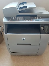 white and gray HP photocopier/printer