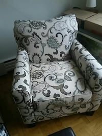 white and gray floral fabric sofa chair