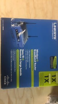 black and blue Linksys wireless router box Mississauga, L4X 1M4