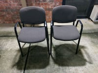 two black metal framed gray padded armchairs Houston, 77082