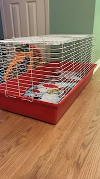 red and white pet cage