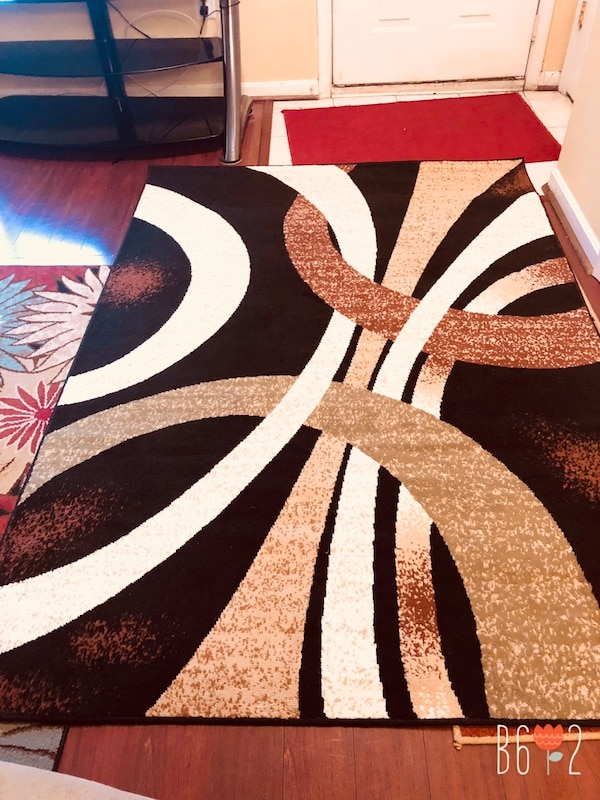 Black, white, and brown area rug