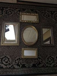assorted brown wooden framed mirrors