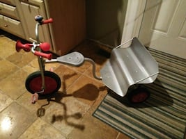 grey and red trike built for two children