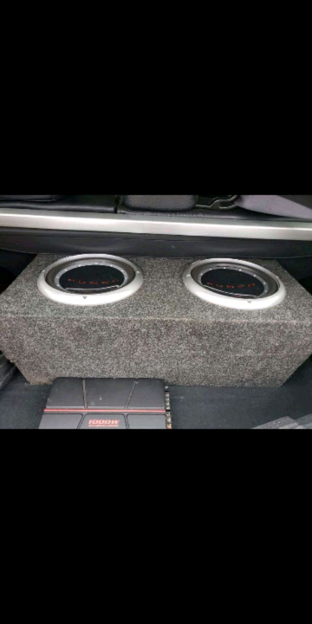 Photo 2 10 inch Roxford Fosgate subs with a 1000 watt Pioneer amp.