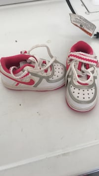 white-and-pin toddler's low-top shoes