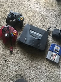 black Nintendo 64 console with controller and game cartridges Denver, 80202