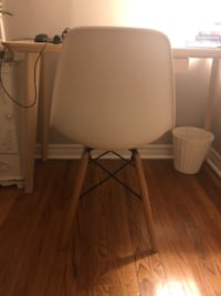 two white leather padded chairs Toronto
